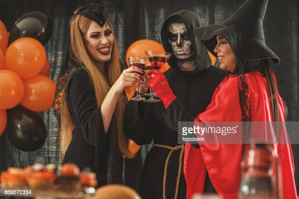 costume party - halloween party stock photos and pictures