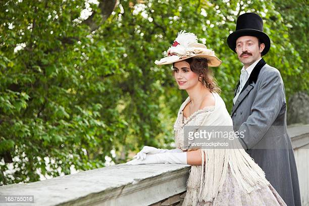 Costume Themed Victorian Couple On Balcony
