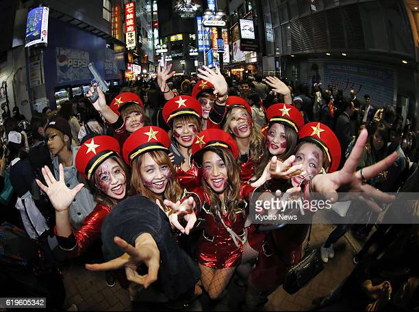 Costumeclad people celebrate Halloween on Oct 31 in Tokyo's Shibuya commercial district Hundreds of police officers were deployed in the area from...