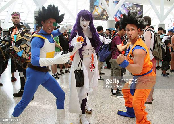Costumeclad people pose for photos at the Anime Expo that began at the Los Angeles Convention Center on July 1 2016 The fourday event featuring...