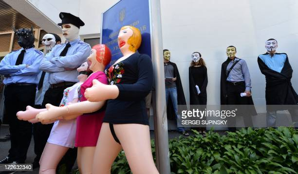 Costumed as policemen activists of the public initiative The movement of Guy Fawkes brought dolls for adults gifting them to the Ukrainian Interior...