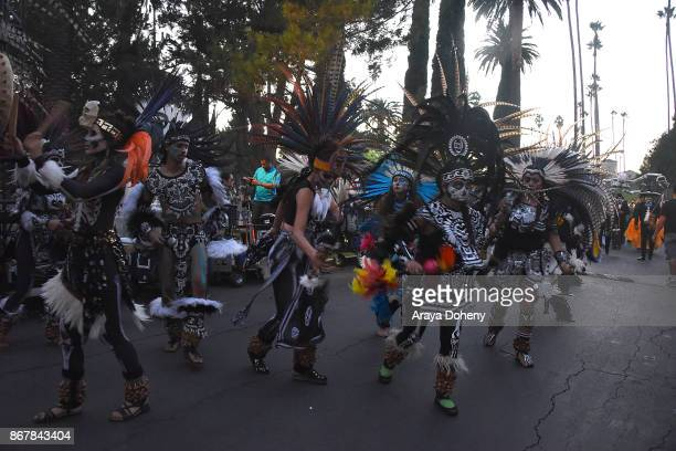 Costumed Aztec Dancers at the Hollywood Forever's Dia De Los Muertos celebration at Hollywood Forever on October 28 2017 in Hollywood California