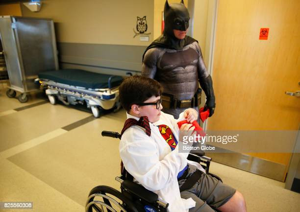 A costumed Batman throws beanbags with Michael Sassine as Boston Comic Con cosplayers visit Spaulding Rehabilitation Hospital in the Charlestown...