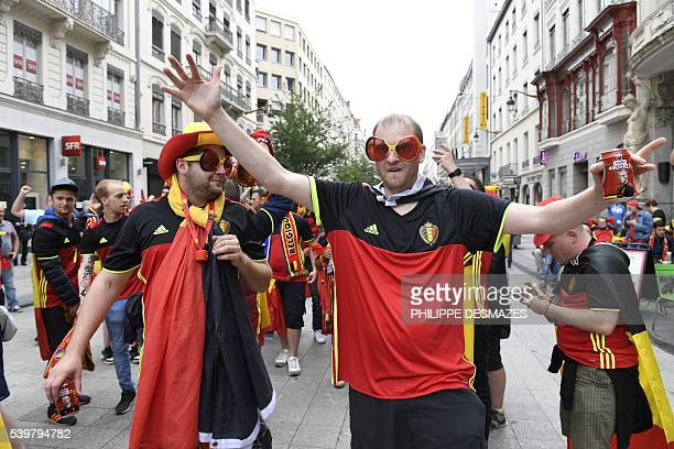 Costumed Belgium supporters sing and dance in a street of Lyon before the Euro 2016 group E football match between Belgium and Italy during the Euro...