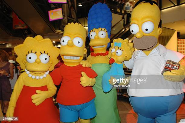 Costumed characters Lisa Simpson Bart Simpson Marge Simpson Maggie Simpson and Homer Simpson pose for a picture while promoting The Simpsons Movie at...
