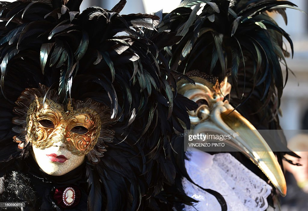 A costumed couple poses at St Mark's square during the carnival on February 3, 2013 in Venice. The 2013 edition of the Venice carnival is untitled ' Live in Colour' and runs from January 26 to February 12.