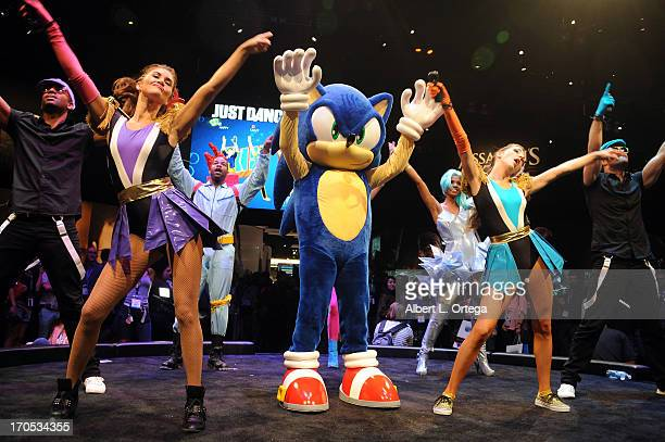Costumed dancers and Sonic participate in Just Dance at Ubisoft at the 2013 E3 Electronic Entertainment Expo at The Los Angeles Convention Center on...