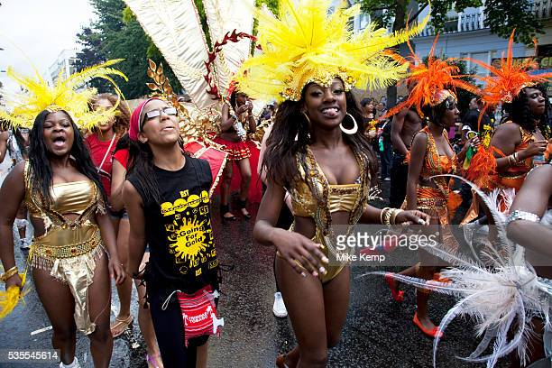 Costumed dancers at the Notting Hill Carnival in West London The Notting Hill Carnival is an annual event which since 1964 has taken place each...