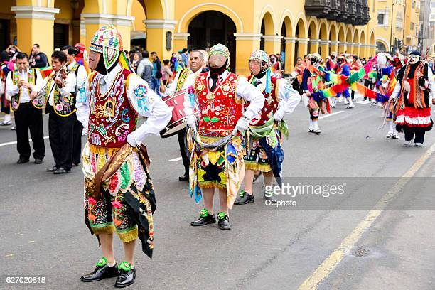 costumed dancers during a traditional celebration. - ogphoto stock pictures, royalty-free photos & images