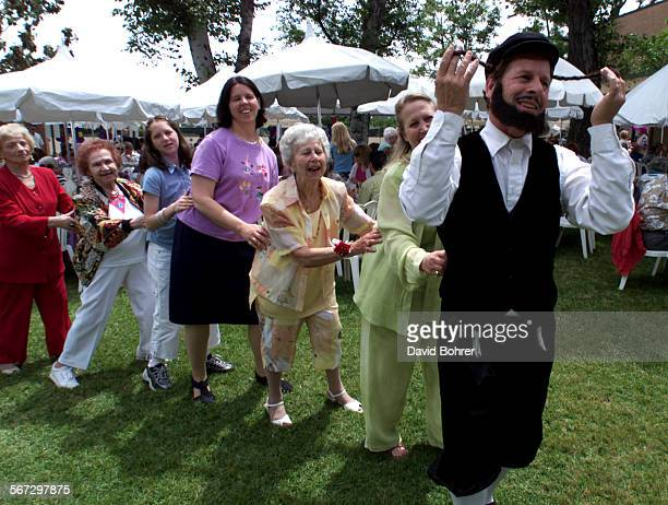 A costumed entertainer leads a group of mother and grandmothers as they dance to traditional jewish songs at the Jewish Home for the Aging in Reseda...
