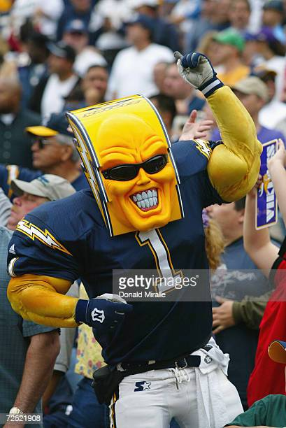 A costumed fan of the San Diego Chargers roots for his team during the game against the Minnesota Vikings on November 9 2003 at Qualcomm Stadium in...