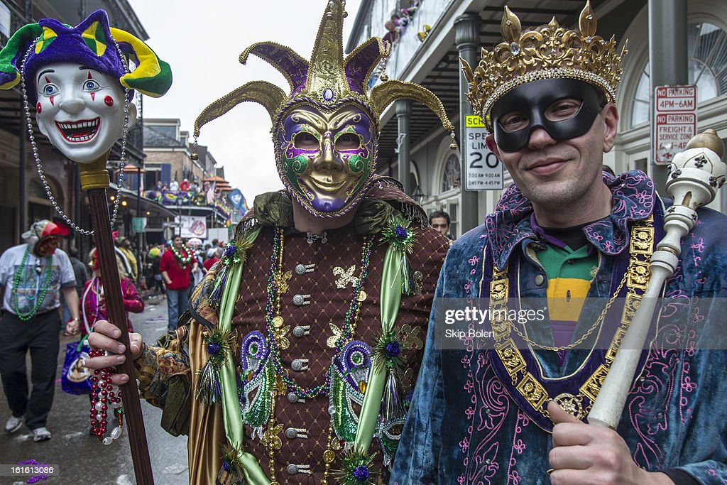 Costumed fans and revelers on Bourbon Street in the historic French Quarter on Mardi Gras Day on February 12, 2013 in New Orleans, Louisiana.