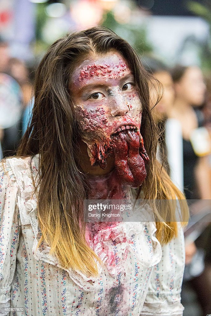Costumed fans attend Comic-Con International at San Diego Convention Center on July 27, 2014 in San Diego, California.