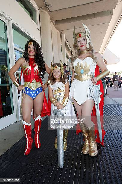Costumed fans Nicole Kiss Alexa Kiss and Nicolle Hanbury pose for photos outside the San Diego Convention Center on July 24 2014 in San Diego...