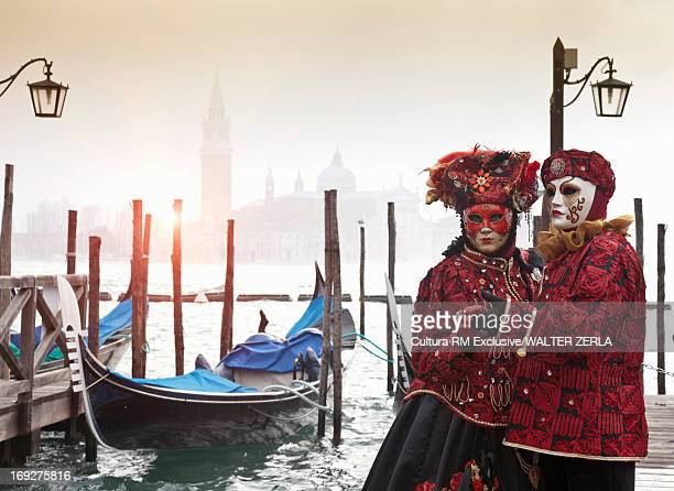 Costumed figures at Venice Carnival