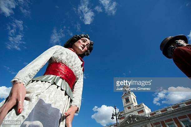 Costumed figures Gigantes and Cabezudos walk the streets of Madrid to begin the festivities of San Isidro on May 10 2013 in Madrid Spain These...