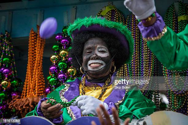 A costumed float rider in the Zulu Social Aid Pleasure Club's 'Zulu Parade' on Jackson Avenue the first parade on the morning of 2013 Mardi Gras on...