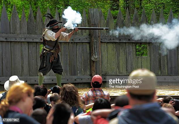 Costumed historical interpreter Sammy Haskell gives a musket demonstration for tourists during a visit to Jamestown Settlement for our travel story...