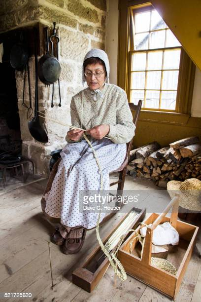costumed interpreter weaves straw hats, historique village acadien, caraquet, new brunswick, canada - historique stock pictures, royalty-free photos & images