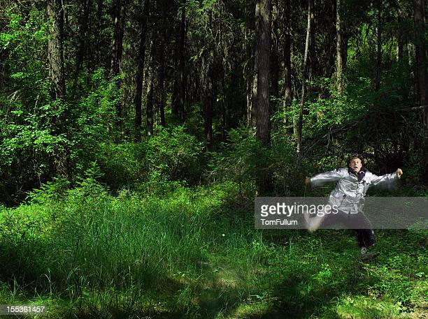 Costumed Man Running Through Forest (Blurred Motion)