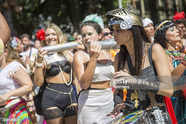 Costumed musicians play instruments during the Bloco das Mulheres Rodadas Carnival parade in Rio de Janeiro, Brazil, on Wednesday, Feb. 10, 2016. The...