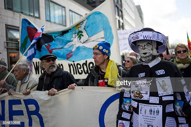A Costumed participants air during the Easter march on in Berlin Germany at the head of the demonstration Under the motto quot Lay Down Your Arms...
