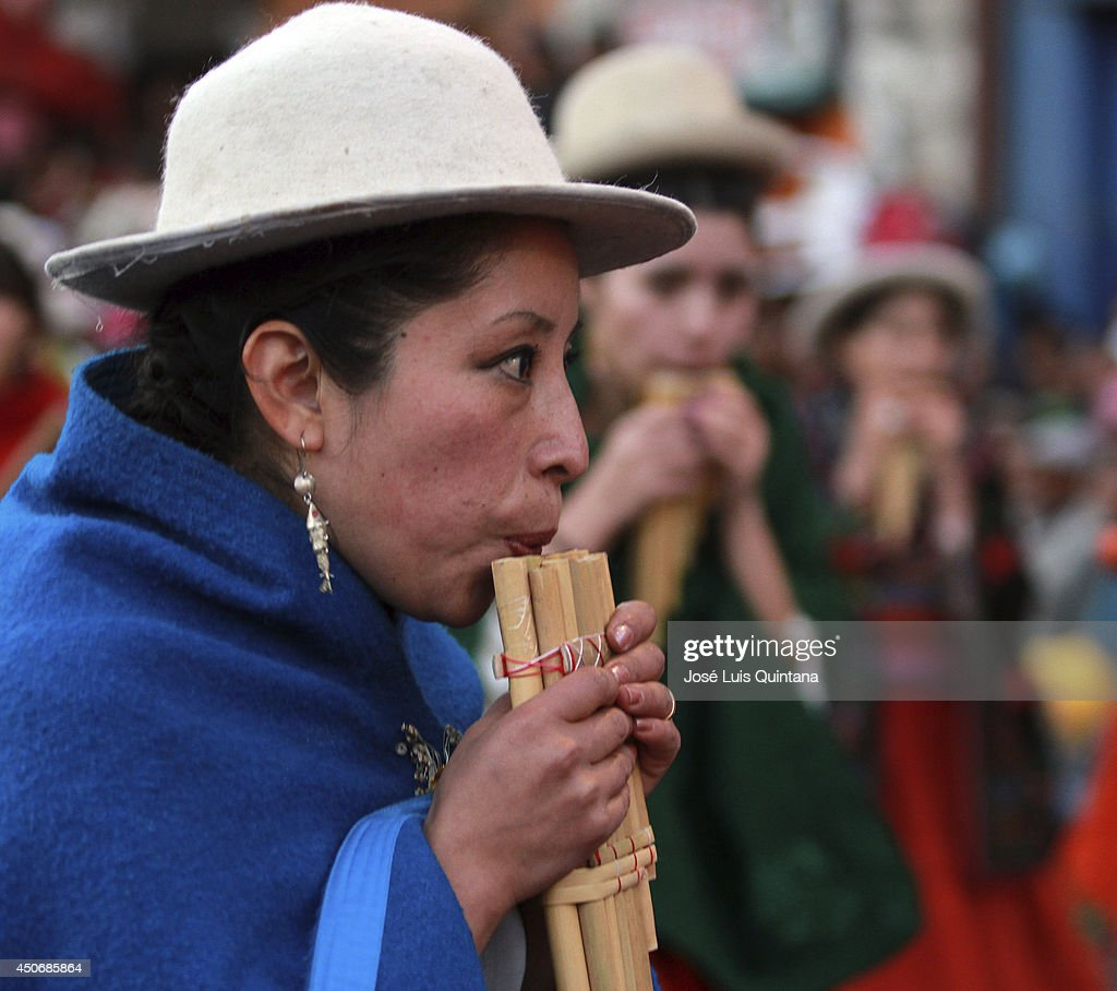 Costumed participants plays Sicuris de Italaque during the religious festival of Jesus del Gran Poder on June 15, 2014 in La Paz, Bolivia. About thirty thousand people attended the event, which is a traditional folk celebration in the country.