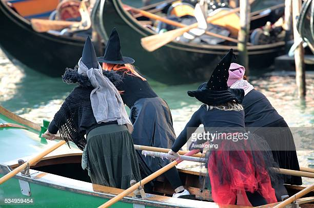 Costumed participants races along the Grand Canal for the 'Befana' Regatta on January 6 2014 in Venice Italy In Italian folklore Befana is an old...