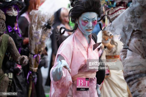 Costumed participants take part in the annual Kawasaki Halloween And Pride Parade on October 28 2018 in Kawasaki Japan