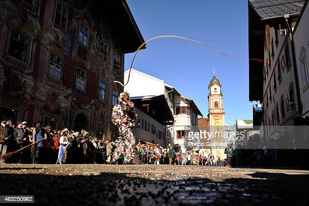 Costumed participants wearing traditional wooden masks perform in the annual carnival parade on February 12, 2015 in Mittenwald, Germany. The German...
