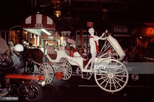 Costumed performer stand in a horse-drawn carriage outside the Chelsea Hotel, New York, New York, 1989. They were on the way to an event hosted by...