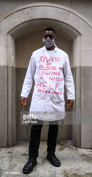 Costumed protestor poses for a photograph before marching in a demonstration calling for the end of police killings of the public in Nigeria, on...