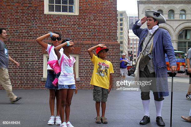Costumed reenactor saluting on The Freedom Trail Old State House