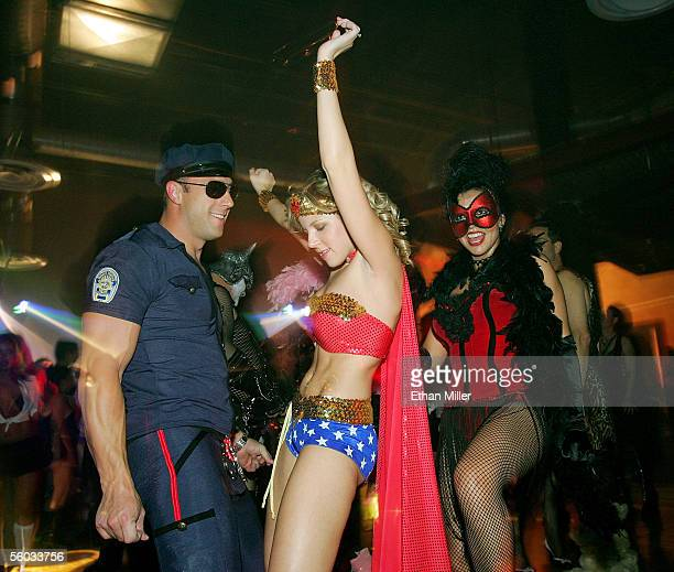 Costumed revelers dance during the 10th annual Fetish Fantasy Halloween Ball at the Las Vegas Sports Center on October 29 2005 in Las Vegas Nevada