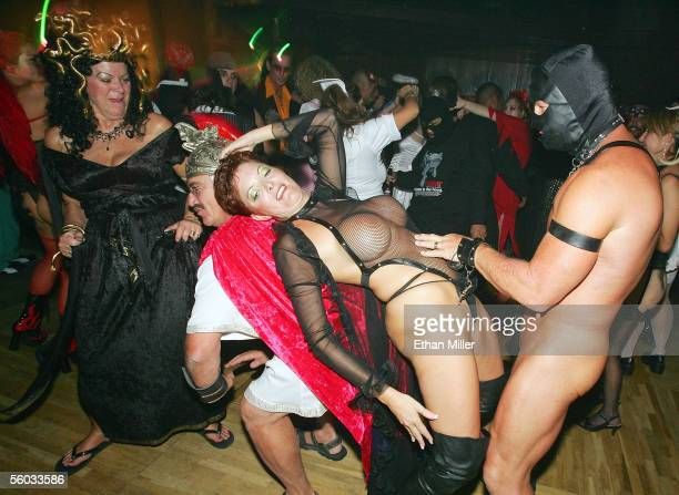 Costumed revelers including Traci and Roy of Nevada dance at the 10th annual Fetish Fantasy Halloween Ball at the Las Vegas Sports Center on October...