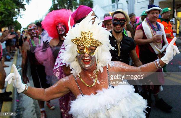 Costumed revelers participate in a Fantasy Fest October 26 2001 in Key West FL The costume and mask event lasts 10 days