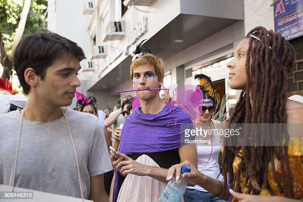 Costumed revelers party in the street during the Bloco das Mulheres Rodadas Carnival parade in Rio de Janeiro, Brazil, on Wednesday, Feb. 10, 2016....
