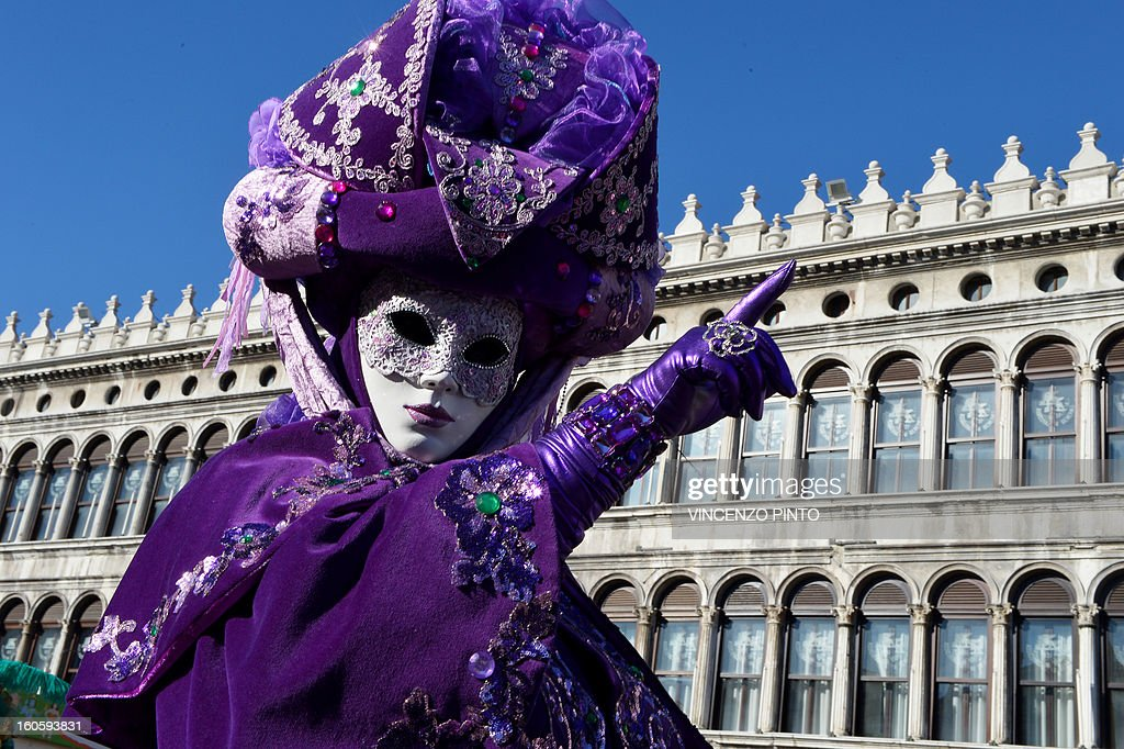 A costumed reveller poses at St Mark's square during the carnival on February 3, 2013 in Venice. The 2013 edition of the Venice carnival is untitled ' Live in Colour' and runs from January 26 to February 12.