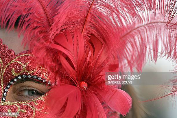 A costumed reveller poses on Saint Mark's square during the carnival on February 21 2014 in Venice The 2014 edition of the Venice carnival is...