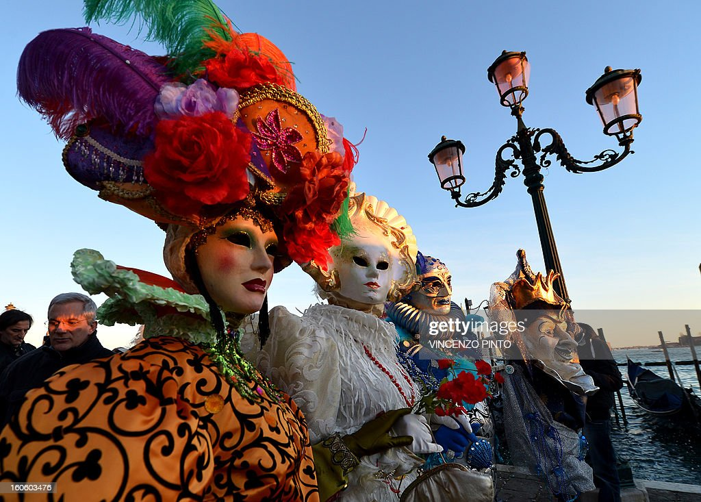 Costumed revellers pose near St Mark's square during the carnival on February 3, 2013 in Venice. The 2013 edition of the Venice carnival is untitled ' Live in Colour' and runs from January 26 to February 12.
