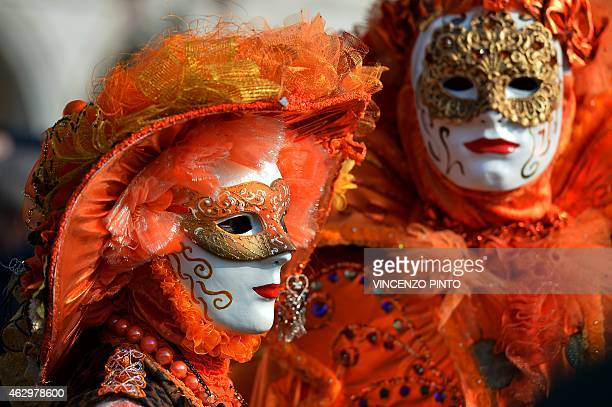 Costumed revellers poses on St Mark's square during the Venice Carnival on February 8 2015 in Venice The 2015 edition of the Venice carnival is...