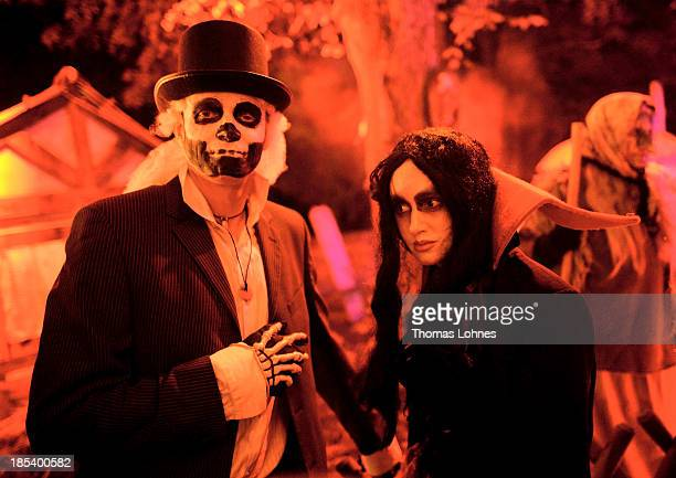 Costumed visitors pose at Frankenstein castle on October 19 2013 in Darmstadt Germany Grotesque monsters howling werewolves longnosed witches and...