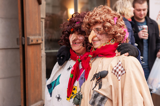 Costumed women in the streets of Prague during the carodejnice festival, or witch burning night 1125024590