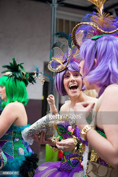 ladies having fun at mardi gras in new orleans - mardi gras parade stock photos and pictures