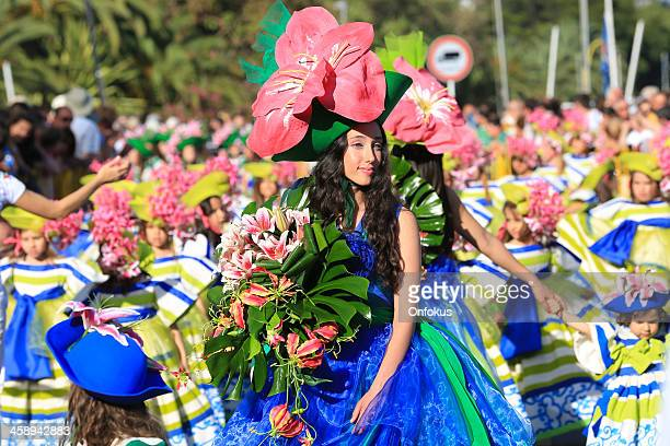 costumed young woman at madeira flower festival parade, portugal - madeira island stock photos and pictures