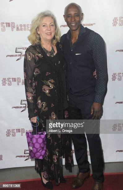 Costumer Deb Hartwell and actor Brian Keith Gamble arrive for the cast and crew screening of 5th Passenger held at TCL Chinese 6 Theatres on December...