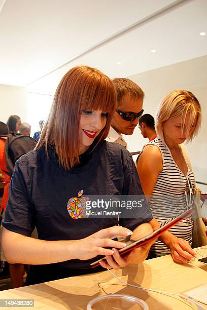 A costumer plays with an iPad during the opening of Apple's New Barcelona Store in Passeig de Gracia on July 28 2012 in Barcelona Spain