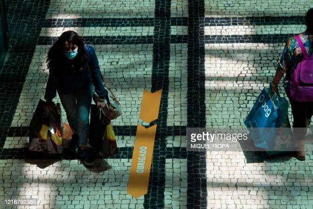 Costumers are pictured at the Norte Shopping Center in Porto on June 1 2020 as the shopping centres reopened after the lockdown to prevent the spread...