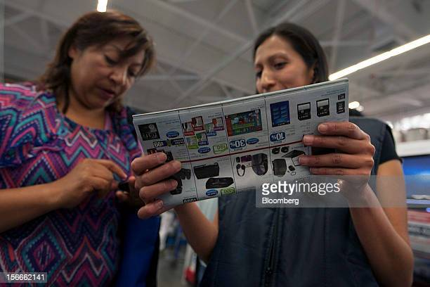 Costumers look for discount offers in the electronics department inside a Sam's Club store in Mexico City Mexico on Saturday Nov 17 2012 El Buen Fin...