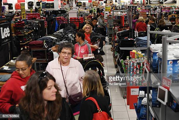 Costumers wait in line to pay while shopping at Kohl's in Lakewood November 25 2016 Customers wait in long lines for Black Friday sales